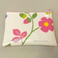 Coin purse in white oilcloth with floral pattern