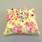 Small pin cushion in yellow with pink flowers