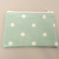 Turquoise coin purse with white spots