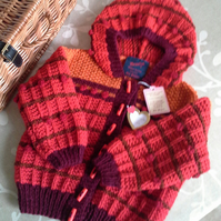 Aran Hand Knitted Hooded Jacket with wool. 18 -24 mths
