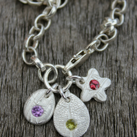 Tiny silver nature charm bracelet with gemstones
