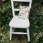 Vintage child's chair with hand-stitched cushion in vintage fabric little boys
