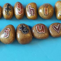 Sparkly golden alphabet stones
