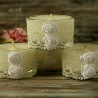 White candles and lace holders, shabby chic decor, boho home decoration