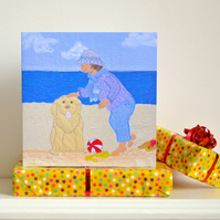 Birthday card with dog on beach by seaside