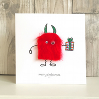 Christmas card - fun mini monster with Christmas gift Christmas present