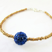 Beaded stacking bracelet, gold and blue