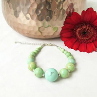 Chunky light green beaded bracelet