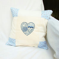 Hand embroidered patchwork cushion cover in shades of blue