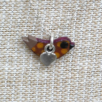 Tiny Bird necklace handmade with wood and sterling silver by Amanda Cope