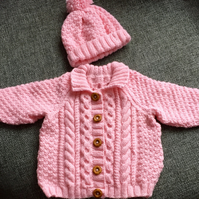 Hand knitted aran style jacket with matching hat