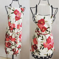 Women's floral apron. Fully lined with matching straps and ties.