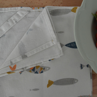 Cotton linen tea towel with a modern fish print and a hanging loop