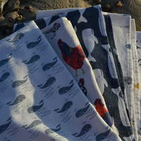 Cotton linen tea towel with a whale print and hanging loop