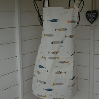 Unisex child's apron with modern fish print.