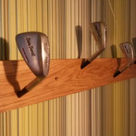 Coat rack for keen golfers, golf club hooks on oak.