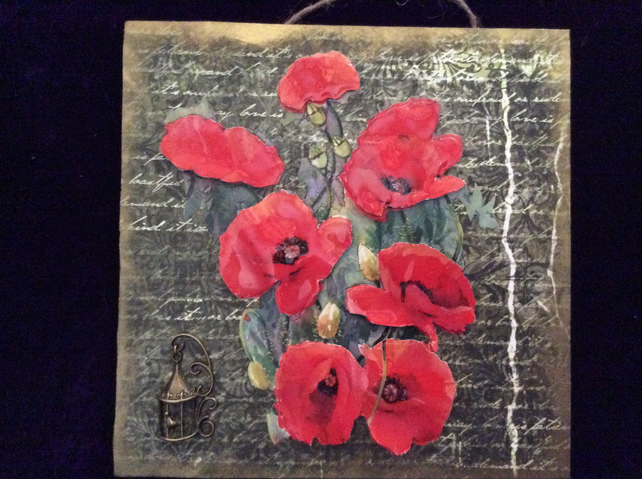 Square plaque with red poppies.