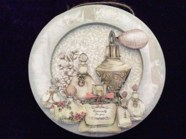 Group of perfume bottles on round MDF plaque