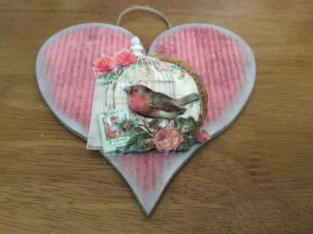 Heart shaped plaqu, with robin, birdcage and roses.