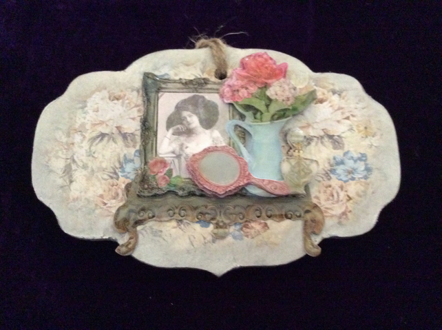 Small fancy shaped MDF plaque with lady, mirror and blue jug.