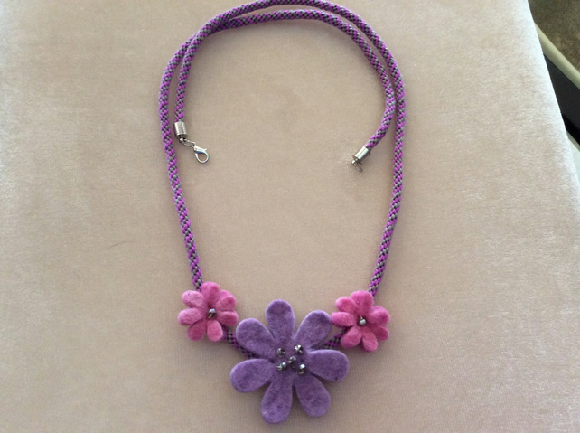 Pink and lilac felt flowers on kumihimo cord