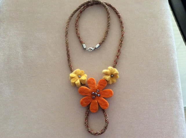 Orange and yellow felt and kumihimo cord necklace.
