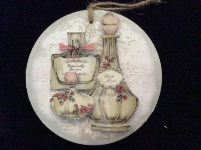 Perfume bottles on small round plaque