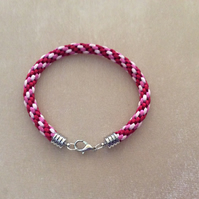 Red pink & silver kumihimo cord bracelet.