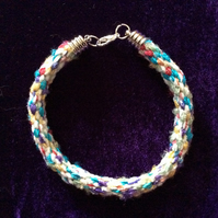 Multi coloured Kumihimo cord bracelet with Silver plated end caps