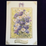 A5 Cream Hammered Card With a Bunch of Blue & White Flowers.