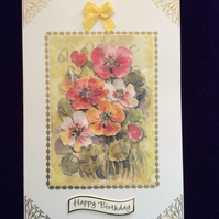 A5 Cream Hammered Card With a Bouquet of Orange & Gold Pansies.