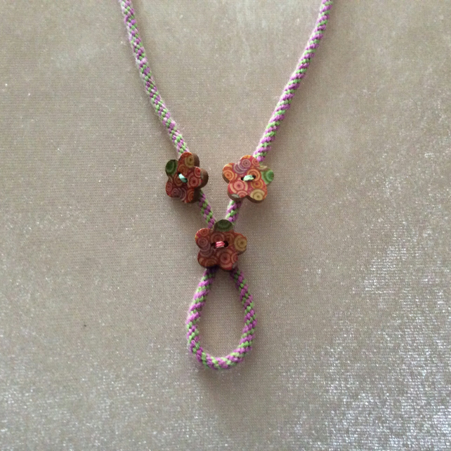 Pink & Green Kumihimo cord necklace with three Wooden Buttons.