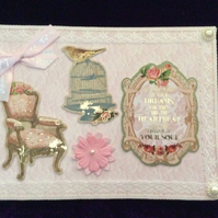 A5 Pink Card With a Chair, Birdcage & Greeting.