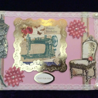 A5 Pink Card With Images Of A Dressmakers Mannequin, Chair & Sewing Machine.