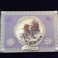 A5 Lilac Card With A Flower Laden Bicycle.
