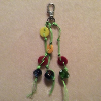 Green, Waxed Cotton Cord Bag Charm With Red, Orange & Yellow Beads & Silver Clas