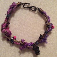 Pink, purple & Brown, Boho Bracelet With Bronze Charms.