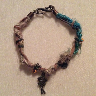 Turquoise & Brown Boho Bracelet With Bronze Charms & Orange Beads.