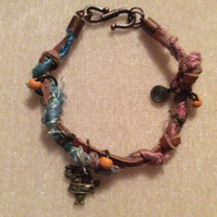 Turquoise, Pink & Brown Boho Bracelet With Bronze Charms.