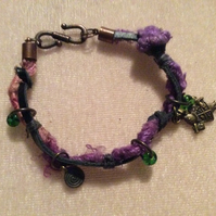 Purple, Peach, Green & Black Boho Bracelet With Bronze Charms.