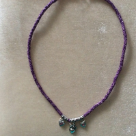Purple Kumihimo Cord With Silver Hearts.