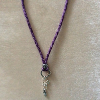 Purple Kumihimo Cord Necklace With Small Silver Charms.