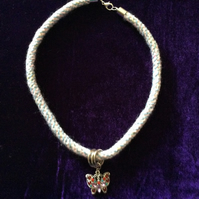 Pale Blue & Pink Kumihimo Cord Choker With A Beaded Butterfly Charm.
