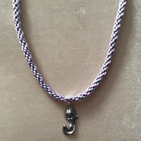 Pink, Lilac & Silver Kumihimo Cord Necklace With a Silver Madonna Charm.