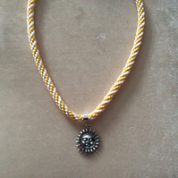 Gold & Silver Kumihimo Cord Necklace With a Silver Sun Charm.