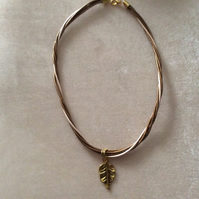 Twisted Leather Cord Necklace With Gold Leaf Charm.