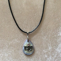Mother of Pearl Pendant with Silver Hearts on a Black Cord.