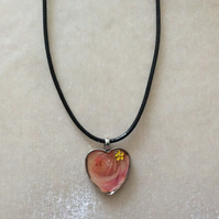 Heart Shaped Silver Pendant With Pink Rose on Black Cord.