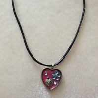 Silver Heart Pendant with Gems on a black cord.