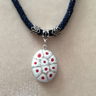 Black Sparkly Kumihimo Cord Necklace With Silver Beads & An Oval Pendant.
